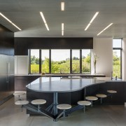 ​​​​​​​This kitchen's informal seating area is shaped to architecture, interior design, custom table, Altus Architecture
