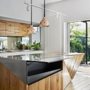 The stainless steel front panel on this kitchen countertop, house, interior design, kitchen, wood, white