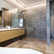 Cantilevering the long vanity allows for maximum countertop bathroom, floor, home, interior design, room, tile, wall, gray