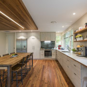Renovation creates large open-plan living space and opens cabinetry, countertop, bencthop, Resene, floor, flooring, hardwood, interior design, kitchen, wood, wood flooring, Higham Architecture, plywood