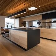 Sleek new kitchen has both a clean-lined design architecture, cabinetry, countertop, cuisine classique, floor, flooring, hardwood, interior design, kitchen, laminate flooring, plywood, wood, wood flooring, brown