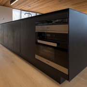 The main black surface is viewed on entering floor, flooring, furniture, wood, black, brown