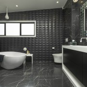 Given a large space for this master bathroom, black, countertop, floor, flooring, interior design, room, tile, wall, black
