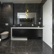 While the owner was keen on having a bathroom, floor, flooring, interior design, room, tile, wall, black