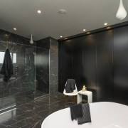 This shower is spacious enough for two, while bathroom, flooring, interior design, room, black, gray