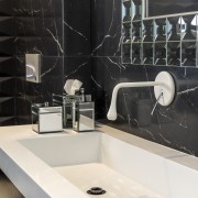 The top of this vanity is a customised bathroom, ceramic, countertop, floor, flooring, interior design, plumbing fixture, room, sink, tap, tile, black, white