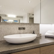Curved lines meet straight lines in the design bathroom, floor, interior design, plumbing fixture, real estate, room, sink, tap, tile, gray
