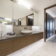 From bed, through compartmentalised separate his and hers countertop, floor, interior design, kitchen, real estate, sink, gray