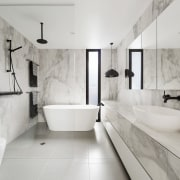 ​​​​​​​Project architect Linda Simons of LSA Architects created architecture, bathroom, tiled floor, home, bathroom design, plumbing fixture, tap, marble, freestanding bath, LSA Architects