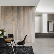 ​​​​​​​When the doors are shut on this wood-clad architecture, floor, flooring, dining furniture, house, interior design, laminate flooring, living room, table, wall, wood, wood flooring, LSA Architects