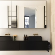 In direct contrast to the curvaceous tub, the bathroom accessory, floor, furniture, interior design, shelf, white