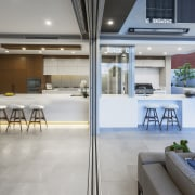 ​​​​​​​A dropped ceiling delineates the indoor kitchen in interior design, gray