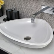 ​​​​​​​Soft-curve triangular basins are complemented by veined marble bathroom sink, ceramic, plumbing fixture, product, sink, tap, gray