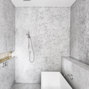 This family bathroom's clean-lined aesthetic also makes it angle, architecture, bathroom, black and white, floor, interior design, plumbing fixture, room, tap, tile, wall, white