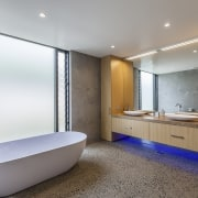 ​​​​​​​Atmospheric lighting and a freestanding tub accompany bespoke architecture, bathroom, room, gray, white, bespoke cabinetry, custom, RH Cabinetmakers, Storeage