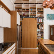 ​​​​​​​Wooden kitchen cabinetry and living room timber shelves cabinetry, countertop, floor, flooring, hardwood, interior design, kitchen, shelf, shelving, wood, wood flooring, brown, gray, cabinetry, RH Cabinetmakers