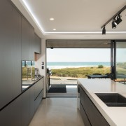 ​​​​​​​On this kitchen design, the perimeter cabinetry's minimalist architecture, countertop, interior design, kitchen, window, di Rosa Kitchen & furniture