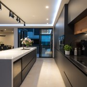 This kitchen is constrained by floor-to-ceiling glass doors architecture, countertop, benchtop, house, interior design, kitchen, black, di Rosa Cabinetry & Furniture