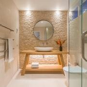 A strong sense of symmetry contributes to the bathroom, interior design, plumbing fixtures, Natalie Du Bois Design, powder room, travertine