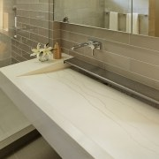 ​​​​​​​This custom-designed sink was cast in glass fibre bathroom, countertop, tiled floor, custom made sink, tap, Cheng Design