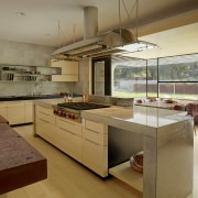 ​​​​​​​Designed by FuTung Cheng, the hood in this cabinetry, countertop, benchtop, interior design, kitchen, FuTung Cheng, Cheng Design, custom hood