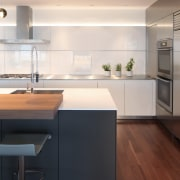 ​​​​​​​Subtle lighting can make all the difference. For architecture, cabinetry, countertop, flooring, hardwood, interior design, kitchen, laminate flooring, sink, wood flooring, white, William Landeros,  Kitchen Distributors