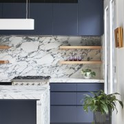 ​​​​​​​The island's marble waterfall benchtop with negative detail cabinetry, countertop, floor, interior design, kitchen, marble waterfall, grey cabinetryRob Nerlich, Mcmahon and Nerlich