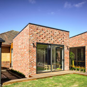 ​​​​​​​Looking like it is stand-alone, this new rumpus brick, facade, home, house, property, rresidential area, siding, bifold window, brick extension, Porter architecture