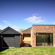 ​​​​​​​Black corrugated iron on the garage provides a backyard, elevation, facade, home, house, property, residential area, roof, shed, siding, extension, brick, Porter architectur