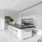 ​​​​​​​The fridge is set to the side of architecture, countertop, benchtop, interior design, kitchen, white cabinetry,  Ceasarstone, Island, Emma Morris, Eterno Design