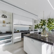 ​​​​​​​This kitchen features two tall wall cabinets, to countertop, interior design, kitchen, white cabinetry, Ceasarstone benchtops, countertop, Emma Morris, Eternodesign,