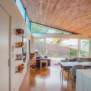 ​​​​​​​On this home by Kamermans Architects, the sloping architecture, ceiling, floor, flooring, hardwood, home, house, interior design, laminate flooring, living room, wood, wood flooring, timber, Frans Kamermans, clerestory
