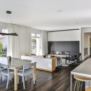 ​​​​​​​On this home renovation, he new living area dining room, interior design, dining table, kitchen, timber floor, living room, Matt Brew