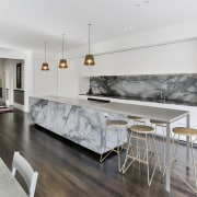 ​​​​​​​For this modernising renovation, the hallway offers line architecture, countertop, benchtop, floor, flooring, interior design, kitchen, living room, wood flooring, white, gray.Matt Brew Architect