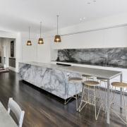 For this modernising renovation, the hallway offers line architecture, countertop, benchtop, floor, flooring, interior design, kitchen, living room, wood flooring, white, gray.Matt Brew Architect