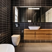 While classic elements were retained elsewhere, the bathrooms bathroom, floor, flooring, home, interior design, room, tile, black, timber vanity, basin