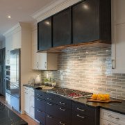 One way to optimise a feature in your cabinetry, countertop, cuisine classique, floor, flooring, home, interior design, kitchen, room, under cabinet lighting, wood flooring, gray, black