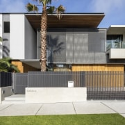 ​​​​​​​Although sited on a corner next to a architecture, backyard, elevation, facade, home, house, property, contemporary, SAOTA