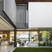 The U-shape design of this house by architects architecture, facade, home, house, interior design, roof, white, outdoor patio, SAOTA