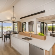​​​​​​​Open sesame. Covered pavilions straight ahead and to countertop, house, interior design, kitchen, Landmark Homes,  Showhome, Coromandel, timber flooring