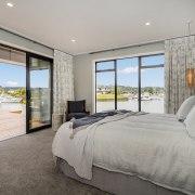 The master bedroom, with, giant sliders retracted, is architecture, bedroom, bed, floor, house, interior design, property, master bedroom, Landmark Homes,  Coromandel