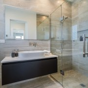 ​​​​​​​Luxury surfaces and modern fixtures feature in the  architecture, master bathroom, home, interior design, Master bathroom, sink, tile, wall, wood flooring, gray, Landmark Homes,  Coromandel showhome