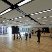 A dance studio on the second floor of ceiling, daylighting, floor, flooring, structure, tourist attraction, gray, brown