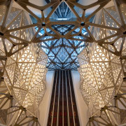 Glass elevators offer a visual feast for guests architecture, ceiling, daylighting, lighting, structure, symmetry, tourist attraction, brown