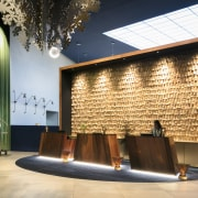 A wall of gold leaves – evoking the architecture, ceiling, facade, interior design, lobby, wall