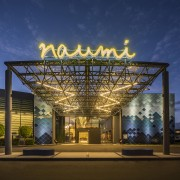 Naumi Auckland Airport Hotel's tiled facade evokes the architecture, building, landmark, sky, structure, tourist attraction, blue, brown
