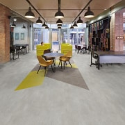 Offices are famously heavy-use spaces and Ployflor vinyl floor, flooring, furniture, hardwood, interior design, laminate flooring, loft, real estate, table, tile, wood flooring, gray