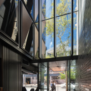 Fitzpatrick & Partners designed a soaring entry lobby apartment, architecture, building, daylighting, facade, glass, home, house, interior design, window, black, gray