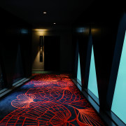 At Sydney's West Hotel, custom woven carpets evoke architecture, darkness, light, lighting, black