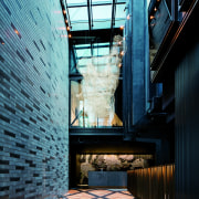 At West Hotel's point of arrival, native flora architecture, building, daylighting, black, teal